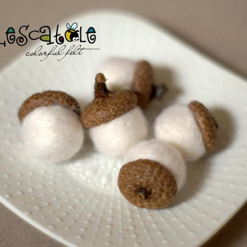 white felted acorns